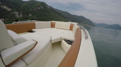 On board view of boat navigating fast on Como lake - stock footage