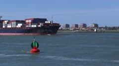 Container ship Schubert inbound at fairway to seaport Rotterdam Stock Footage