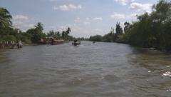 River bank and boats sailing at The Mekong Delta, Vietnam Stock Footage