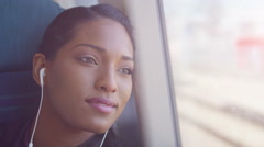 4k Beautiful woman with earphones relaxing on train journey Stock Footage