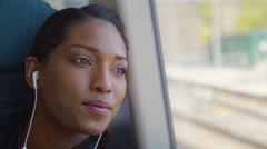 4k Beautiful woman with earphones relaxing on train journey Stock Footage