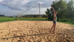 Girl make a volleyball training on the beach. Stock Footage