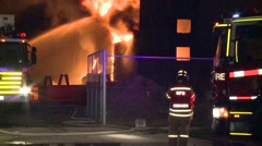 Huge Refinery Fire Fire fighters on scene Stock Footage