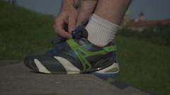 Runner stops for lacing running footwear. - stock footage