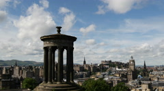 View over Edinburgh, with the Dugald Stewart Monument in the foreground Stock Footage