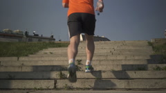 Man running up the stairs. Stock Footage