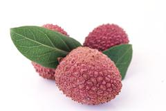 Litchi, litchees on Background Stock Photos