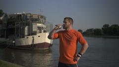 Man drinking water against the boat. Stock Footage