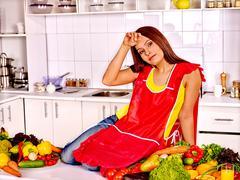 Unhappy tired woman at kitchen Stock Photos