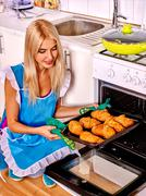 Woman bake cookies - stock photo
