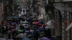 Cars traveling down umbrella filled Via dei Condotti Stock Footage