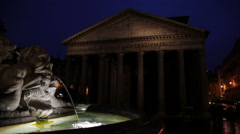 Face in the base of Trevi Fountain shooting water at night. - stock footage