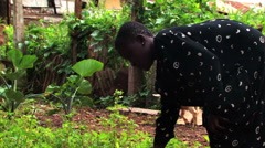 Young deaf girl working in the garden near goats. Stock Footage