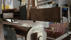 Old loom making fabric Stock Footage