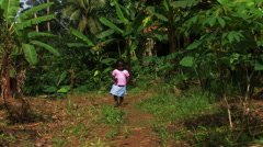 Little African girl walking up a path towards the camera. Stock Footage