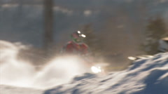 Snowmobilers jumping in a race. Stock Footage