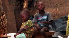 Two African boys sitting. Stock Footage