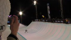 Snowboarder in a half-pipe contest. Stock Footage