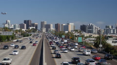 San Diego traffic with an Airplane plane flying over Stock Footage