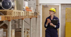 Warehouse employee scanning boxes - stock footage