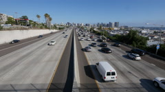 Wide shot of traffic entering downtown San Diego Stock Footage