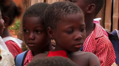 Close up of a little African girl surrounded by other kids. Stock Footage