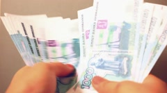 Women hands counting Russian banknotes Stock Footage