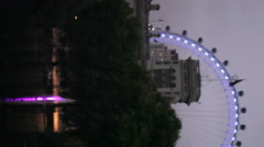 Vertical shot of the Millennium wheel at night in London Stock Footage
