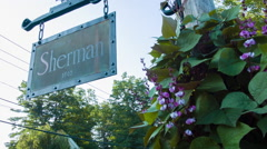 Sherman Town Marker, hanging sign with flowers Connecticut Stock Footage