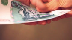 Women hands counting Russian banknotes and delivered the other hand Stock Footage