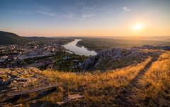 View of Small City with River from the Hill at Sunset Kuvituskuvat