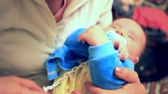 Mother parent holding his young crying screaming baby in her hands Stock Footage