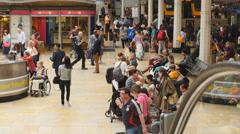 Passengers on escalator pan to info at Paddington 4K Stock Footage