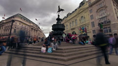 LONDON - OCTOBER 7: Time lapse as people walk by the Eros statue on October 7, Stock Footage