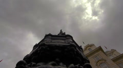 Birds landing on the Eros statue in London Stock Footage