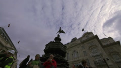 LONDON - OCTOBER 7: Time lapse as unidentified couple sit on the Eros statue on Stock Footage