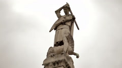 Statue of St. George slaying the dragon near Westminster Abbey, London. - stock footage