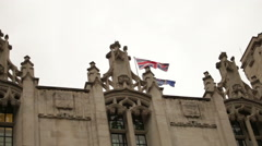 Union Jack flying above an ornate rooftop near Westminster Palace. Stock Footage