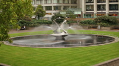 Stationary view of Revolving torsion Fountain Sculpture in London, England. Stock Footage