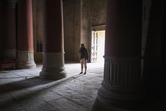 Caucasian tourist standing in ancient building Stock Photos