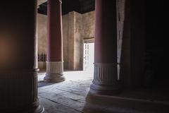 Open door and pillars in ancient building Stock Photos