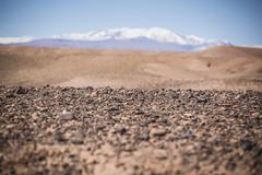 Surface level view of gravel field and remote desert Stock Photos