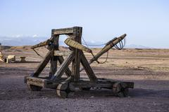 Catapult weapon in remote desert Stock Photos