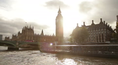 Sun Glare behind Big Ben and Westminster palace in London, England. - stock footage