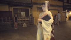 Geisha walking down the street in the Gion district of Kyoto Stock Footage