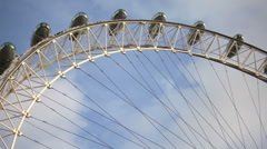 Low angle view of the London eye with blue sky background in London, England. Stock Footage