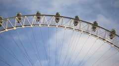Blue sky background with the London eye in foreground in London, England. Stock Footage