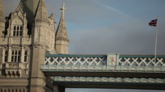 Panning view of the top left tower on Tower Bridge, pans to the right, located Stock Footage