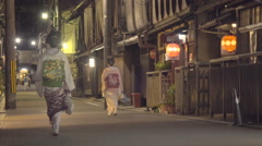 Two Geisha walking down the street in the Gion district of Kyoto Stock Footage