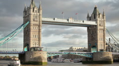 Stationary shot of Tower Bridge, white ship on the left, located in London, Stock Footage